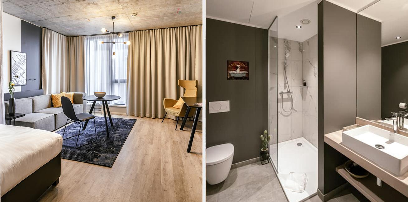 Ansicht des Wohnraumes und des Badezimmers eines JOYN Serviced Apartments Smart Plus