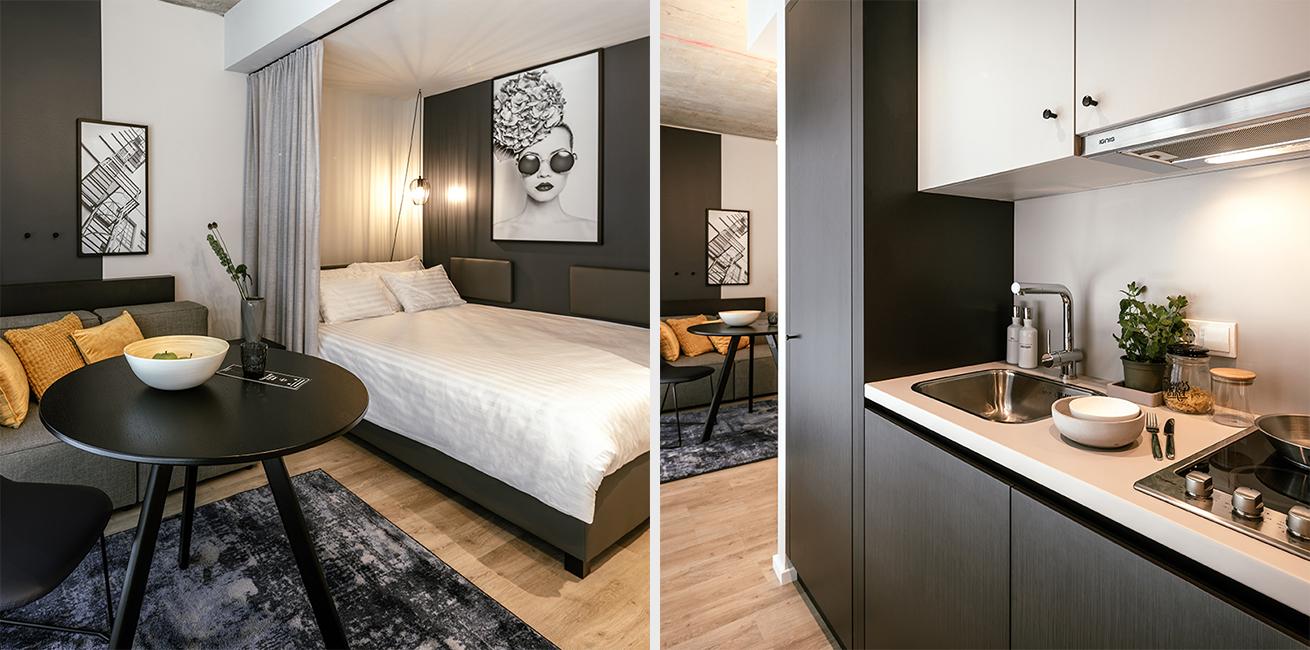 Ansicht des Betts und der integrierten Küche eines JOYN Serviced Apartments Smart