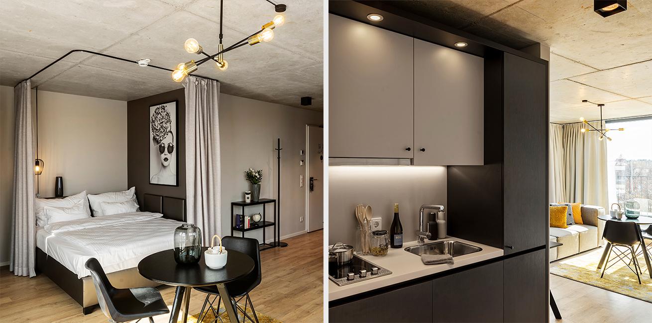 Ansicht des Wohnraumes und der integrierten Kitchenette eines JOYN Serviced Apartment Studios Plus