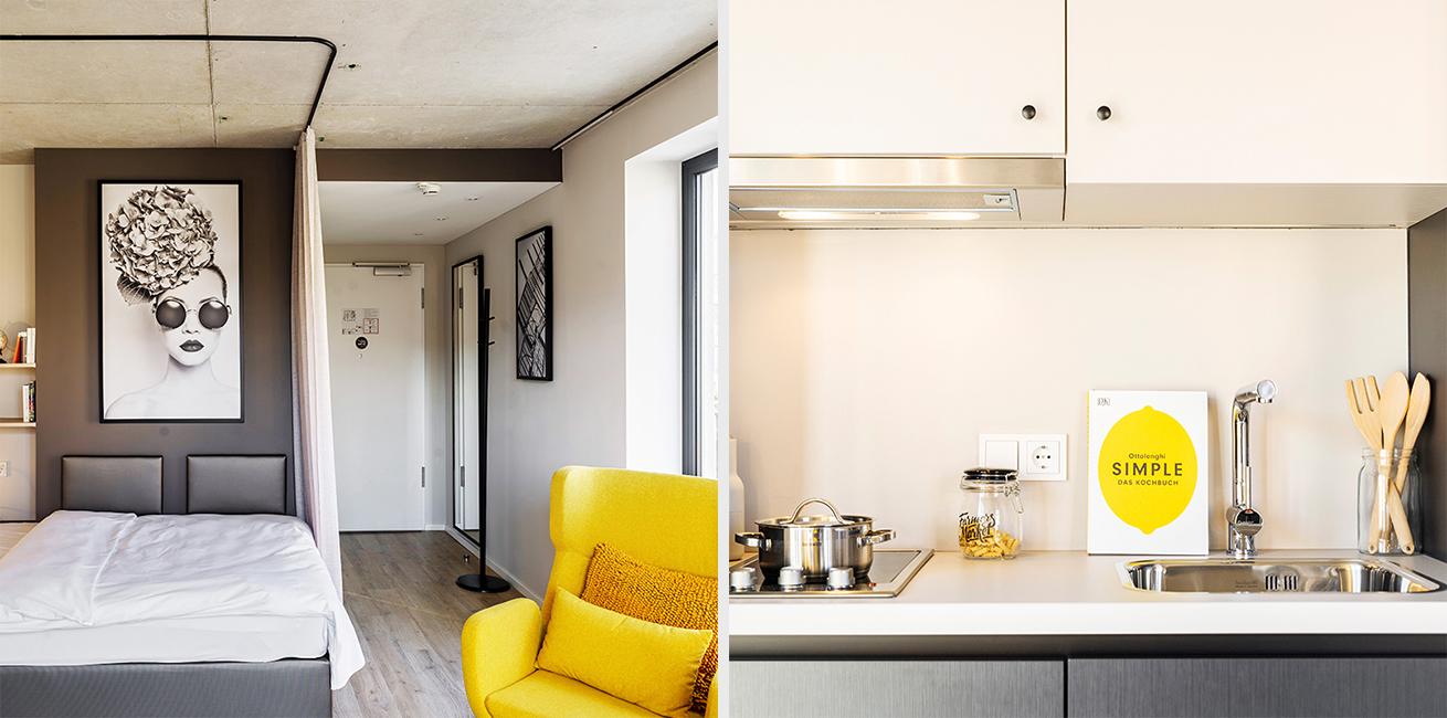 Ansicht des Betts und der integrierten Küchenzeile eines JOYN Serviced Apartment Studios